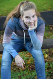 Teenager girl sitting on a bench Royalty Free Stock Photography