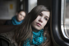 Teenager girl sitting in the carriage Stock Image