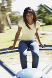 Teenager Girl Sitting On Playground Roundabout Stock Photography