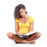 Teenager girl sitting and studying Royalty Free Stock Images