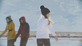 Teenager girl skillfully skating on public ice rink. Youth pastime and rest stock footage