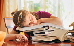 Teenager girl sleeping on books Royalty Free Stock Photography