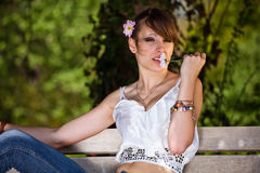 Teenager girl smelling flower Stock Photography