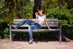 Teenager girl smelling flower Stock Images
