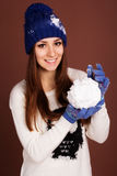 Teenager girl with snowball Stock Photography