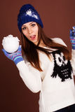 Teenager girl with snowball Stock Photo