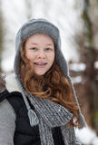 Teenager girl in a snowy park Stock Image