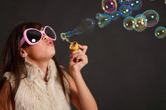 Teenager girl and soap bubbles Stock Image