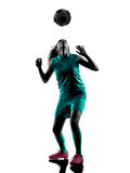 Teenager girl soccer player isolated silhouette. One teenager girl child  playing soccer player in silhouette isolated on white background Stock Photo