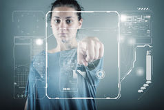 Teenager girl standing. And working wth touch screen technology Stock Images