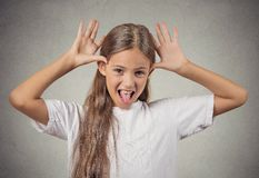 Teenager girl sticking out tongue mocking someone Royalty Free Stock Photography