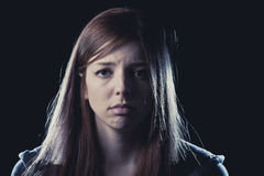 Teenager girl in stress and pain suffering depression sad and scared in fear face expression Stock Photo