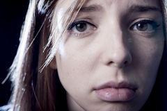 Teenager girl in stress and pain suffering depression sad and scared in fear face expression Stock Photography