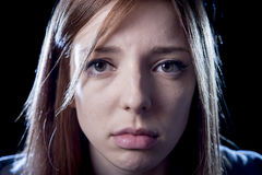Teenager girl in stress and pain suffering depression sad and scared in fear face expression Royalty Free Stock Photos