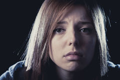 Teenager girl in stress and pain suffering depression sad and scared in fear face expression Stock Photos