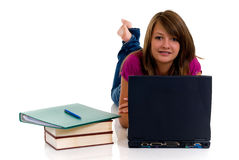 Teenager girl studying. Teenager girls studying with computer and books on white background Stock Photo