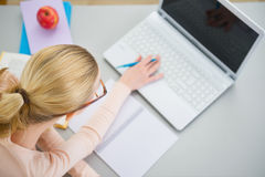 Teenager girl studying in the kitchen Royalty Free Stock Photo