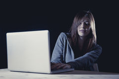 Teenager girl suffering cyberbullying scared and depressed exposed to cyber bullying and internet harassment. Feeling sad and vulnerable in internet stalker Stock Photo