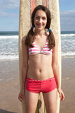 Teenager girl with surf. Board smiling Royalty Free Stock Photo