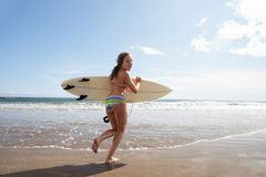 Teenager girl with surfboard Stock Photos
