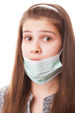 Teenager girl in surgical mask. Portrait teenager girl on a white background Royalty Free Stock Photo