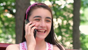 Teenager girl talking on smartphone close up stock footage