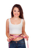 Teenager girl with tape measure Stock Image