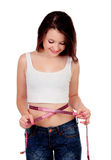 Teenager girl with tape measure Royalty Free Stock Photography