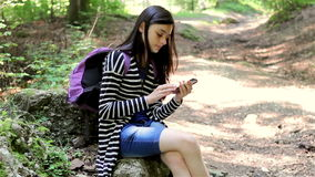 Teenager girl tourist using smartphone stock video footage