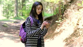 Teenager girl tourist using smartphone stock video