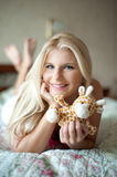Teenager girl with toy on her bed Stock Images
