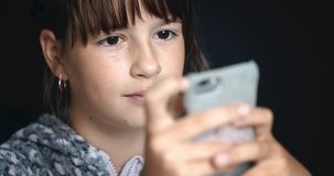 Teenager Girl Use Smartphone. Teenager girl is using smartphone for browsing social network for chatting stock footage