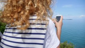 Teenager Girl Using Smart Phone Enjoying Sea View stock video footage