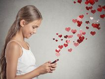Teenager girl using texting on smart phone Stock Images