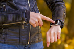 Teenager girl using touchscreen smartwatch Stock Image