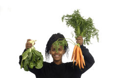 Teenager girl with vegetables Royalty Free Stock Image