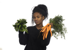 Teenager girl with vegetables Royalty Free Stock Images