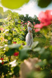 Teenager girl in wedding dress. In nature green park with rose and sunset light Stock Image
