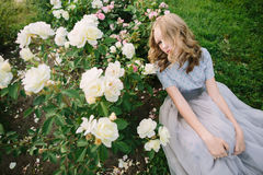 Teenager girl in wedding dress. In nature green park with rose and sunset light in nature green park with rose and sunset light Royalty Free Stock Image