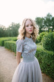 Teenager girl in wedding dress. In nature green  park and sunset light Stock Images