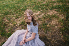 Teenager girl in wedding dress. In nature green park with and sunset light Royalty Free Stock Photos