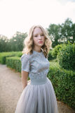 Teenager girl in wedding dress. In nature green  park and sunset light Royalty Free Stock Photos