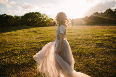 Teenager girl in wedding dress. In nature green park with and sunset light Royalty Free Stock Photography