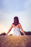 Teenager girl at wheat field Royalty Free Stock Images