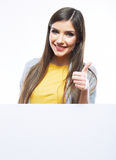 Teenager girl with white blank board. White backgr Royalty Free Stock Image