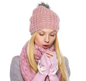 Teenager girl in winter hat and scarf warming hands Royalty Free Stock Images
