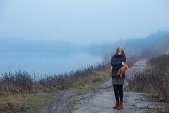 Free Teenager Girl With  Teddy Bear On Country Road By Foggy  Lake.  Concept Of Adolescence And Adolescent Problems Stock Image - 174625621