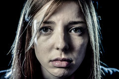 Teenager girl or woman in stress and pain suffering depression looking sad stock image
