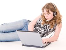 Teenager girl working on laptop Royalty Free Stock Photos