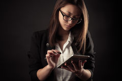 Teenager girl working with tablet Stock Photo